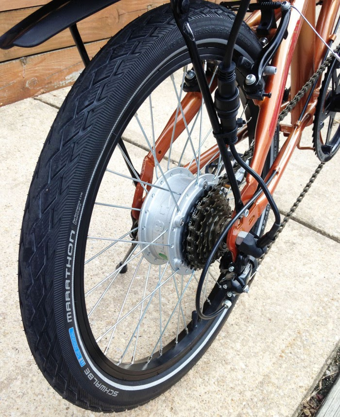 close up of a 20-inch tire on an orange bike