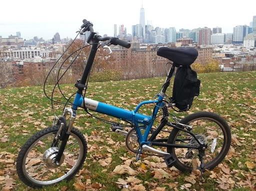 blue folding bike with rear-wheel e-bike kit