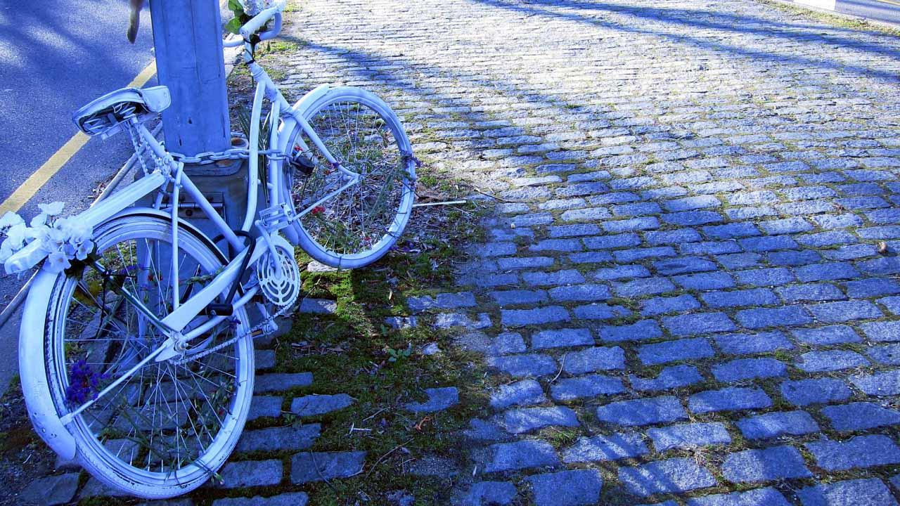 ghost bike on street corner memorial