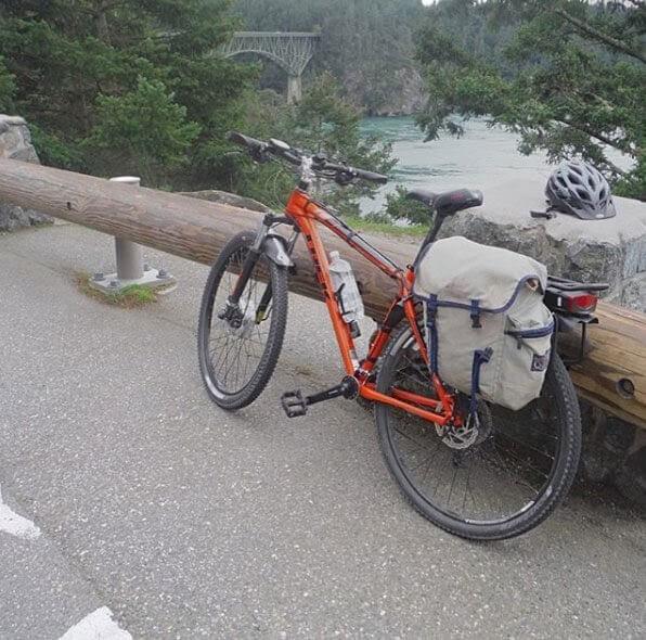 orange e-bike on the Los Gatos Creek Trail in California