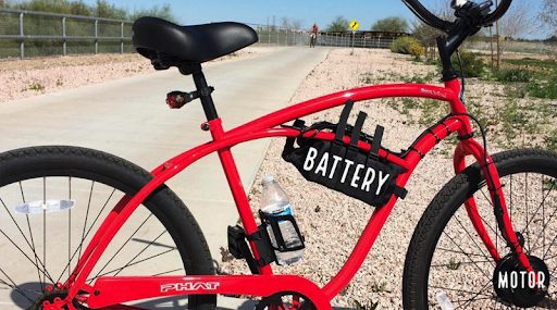 red e-bike with battery and motor labeled