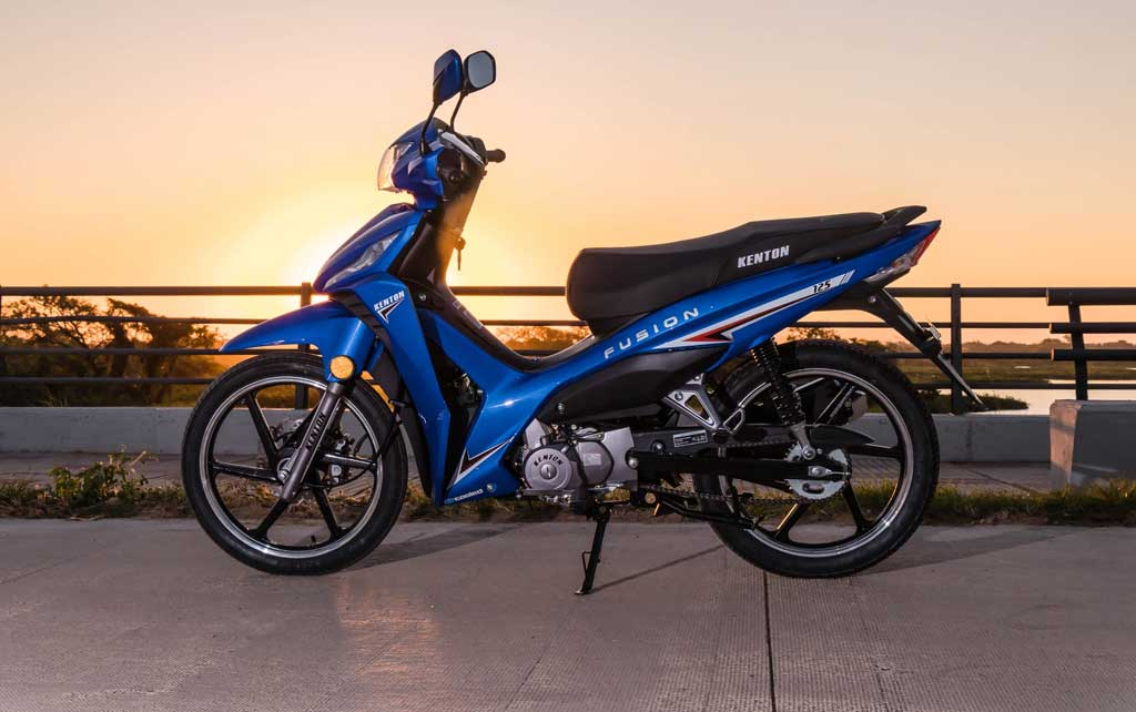 blue moped at sunset