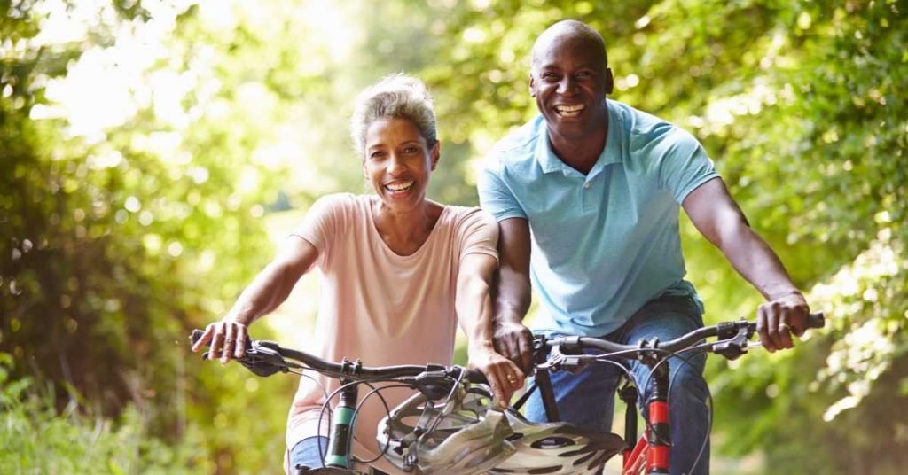 A woman & a man with their Ebikes