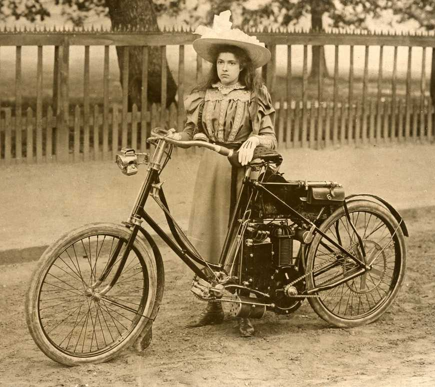 A girl with an earlier motorised bike
