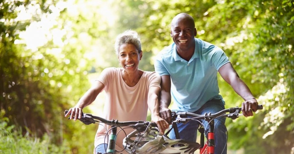 A man and a woman with their E-bikes