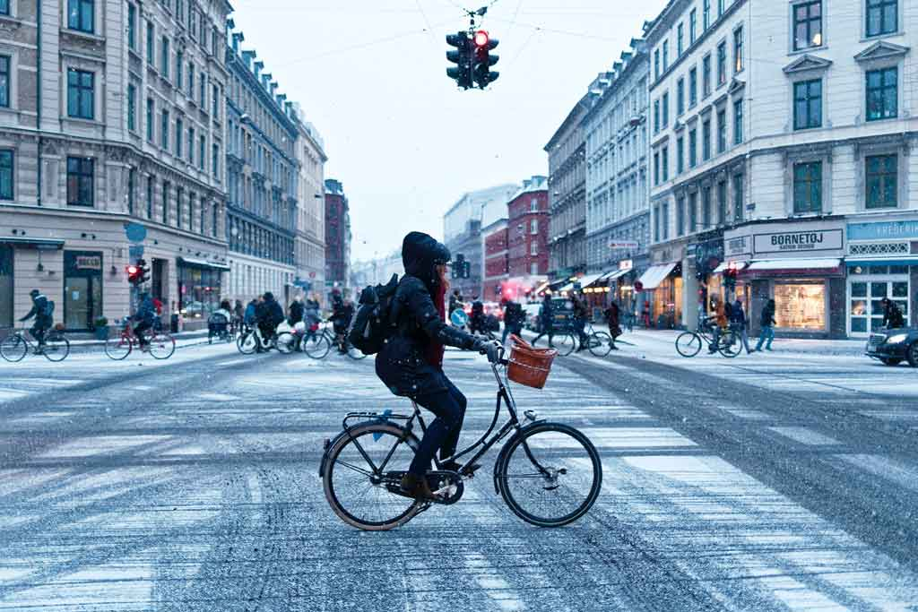 person riding an electric bike in the city during winter