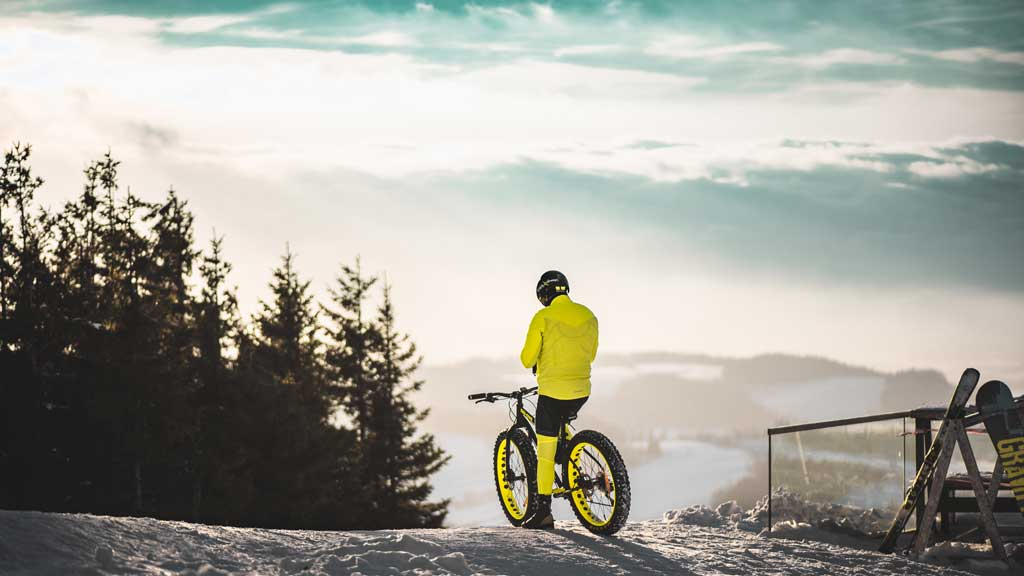 person on a mountain bike in the winter