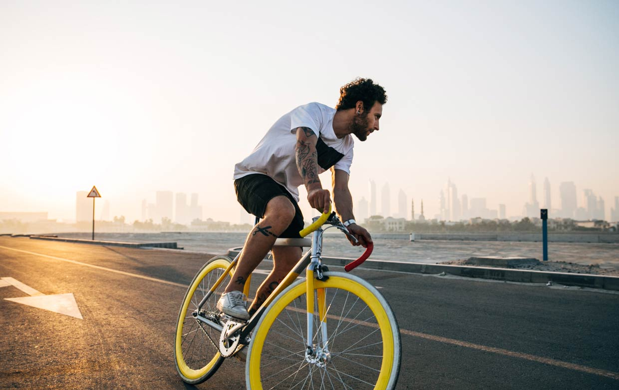 Man riding a bicycle to meet his cycling goals